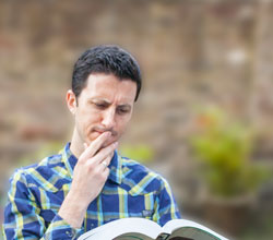 man reading looking troubled