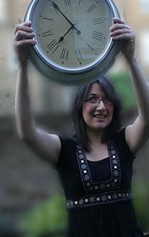 Women holding up a clock